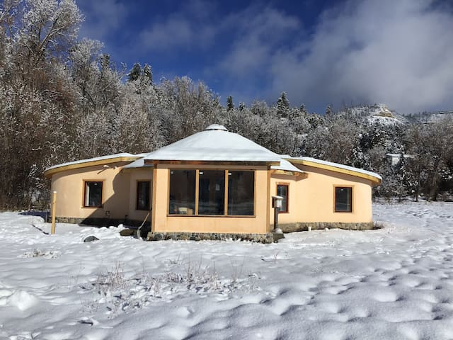 Winter pic of the front of our home showing the solarium.