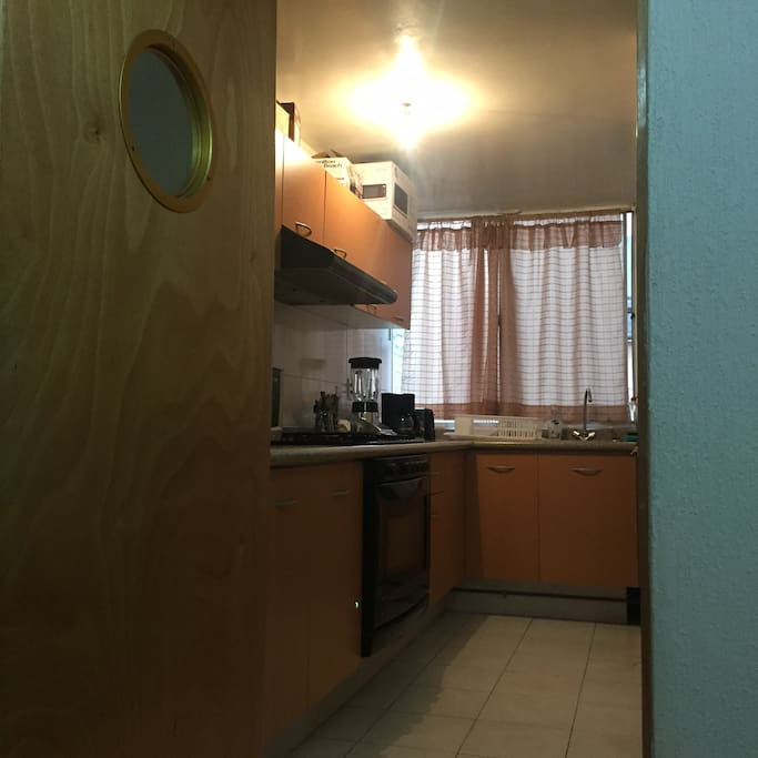 fully equipped kitchen with microwave, oven and everything you need to cook, there is also a washing machine and fridge of course.