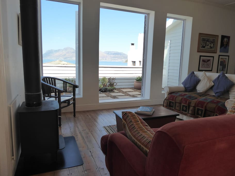 The main living area opens onto a balcony with sea views across to Simon's Town on the other side of the bay.