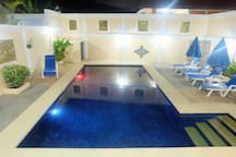 Pool area, where you can relax with your family and friends and chill out. The pool is 8 meters by 4 meters and the shallow end is 1.2 meters and the deep end is 1.8 meters. The pool lights work on a timer.