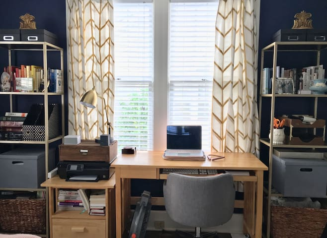 Get work done at a well-lit workspace in the bedroom/office combo.