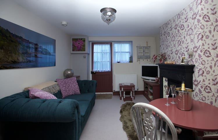 Large 2 seater sofa, dining table, HD TV with built in freeview and a cosy fire.