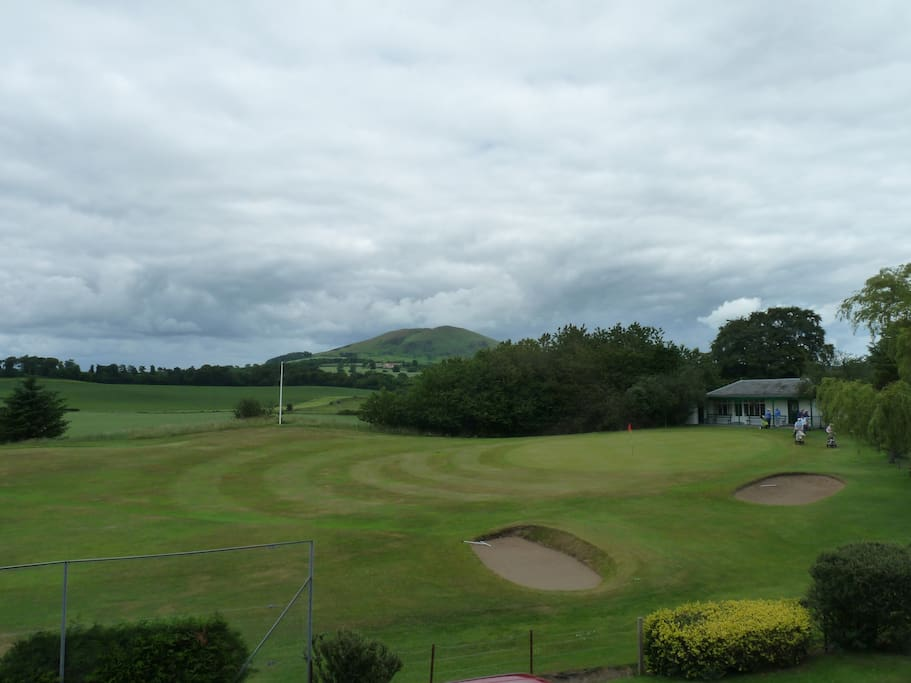 View of ninth hole and clubhouse from front bedroom
