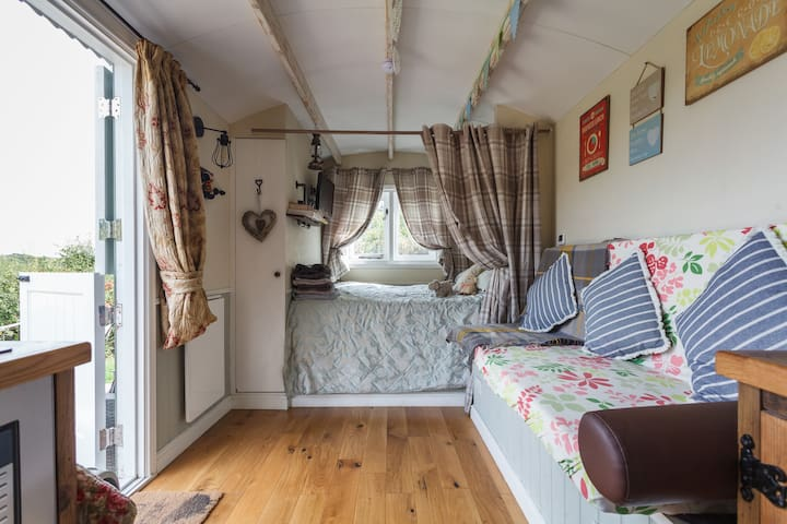 Comfy double bed, small wardrobe for hanging clothes