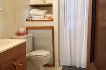 Old pic, pre-renovation.  We continue to upgrade the property, this is the old bathroom for comparison to the new one.   Bath with shower. Towels,  toiletries, hairdryer, iron, and small ironing board  provided.