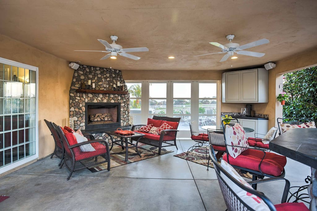 Warm up by the fireplace on the covered patio!