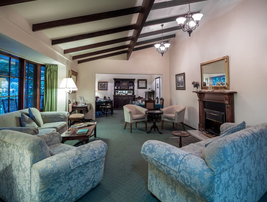 Our comfortable guest lounge and dining room with access to the front deck!