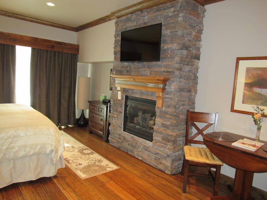 Stone fireplace - flat screen satellite TV