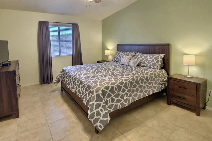 Large Master bedroom with king bed, walk-in closet and master bathroom