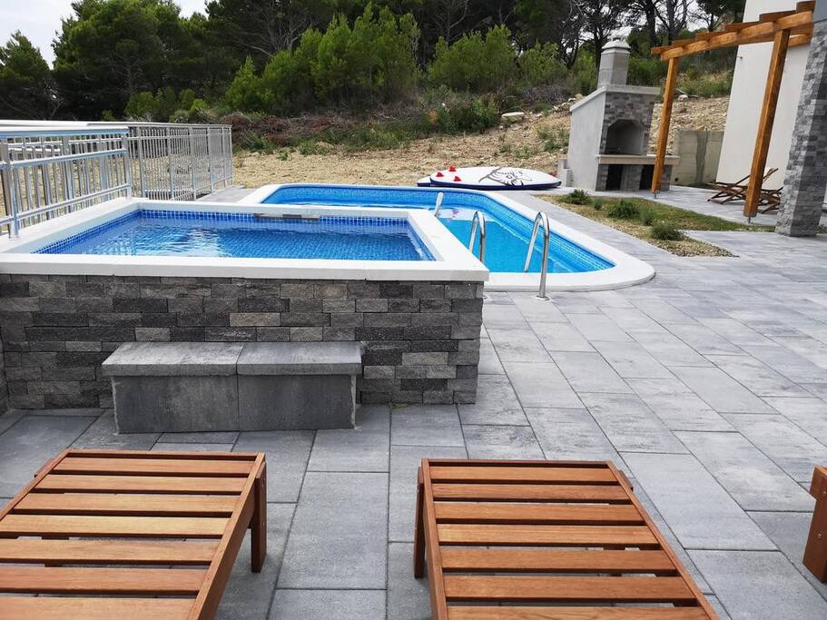 Swimming pool, garden and the barbecue