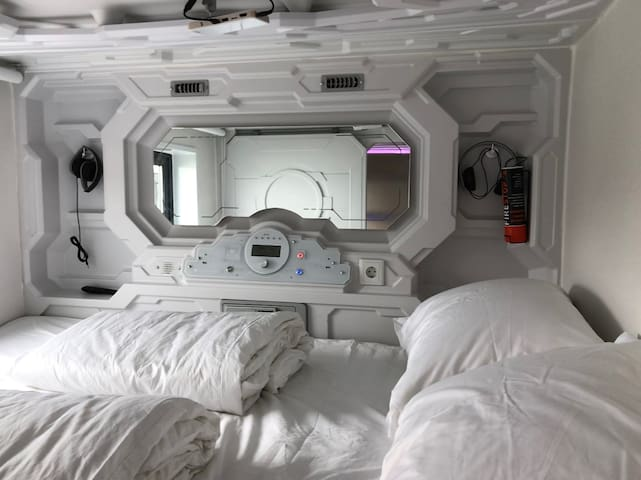 One of the pods. All pods include TEMPUR mattress, two TEMPUR pillows, two hotel-standard pillows and duvets as well as two sets of headphones and a projector for watching movies