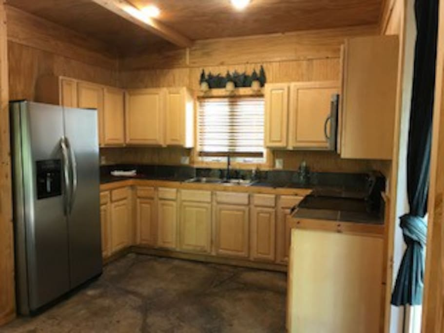 Full kitchen with fridge, stove, oven, and microwave.