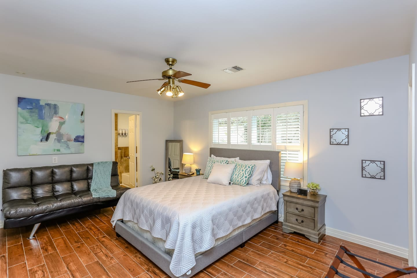 Large Master bedroom with Queen Bed, Full size futon, Walk in closet and private master bath with separate stand up shower and relaxing tub.