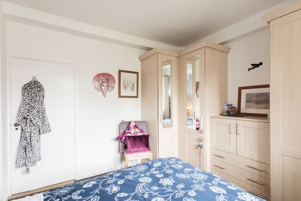 Full length mirror and chair in guest bedroom