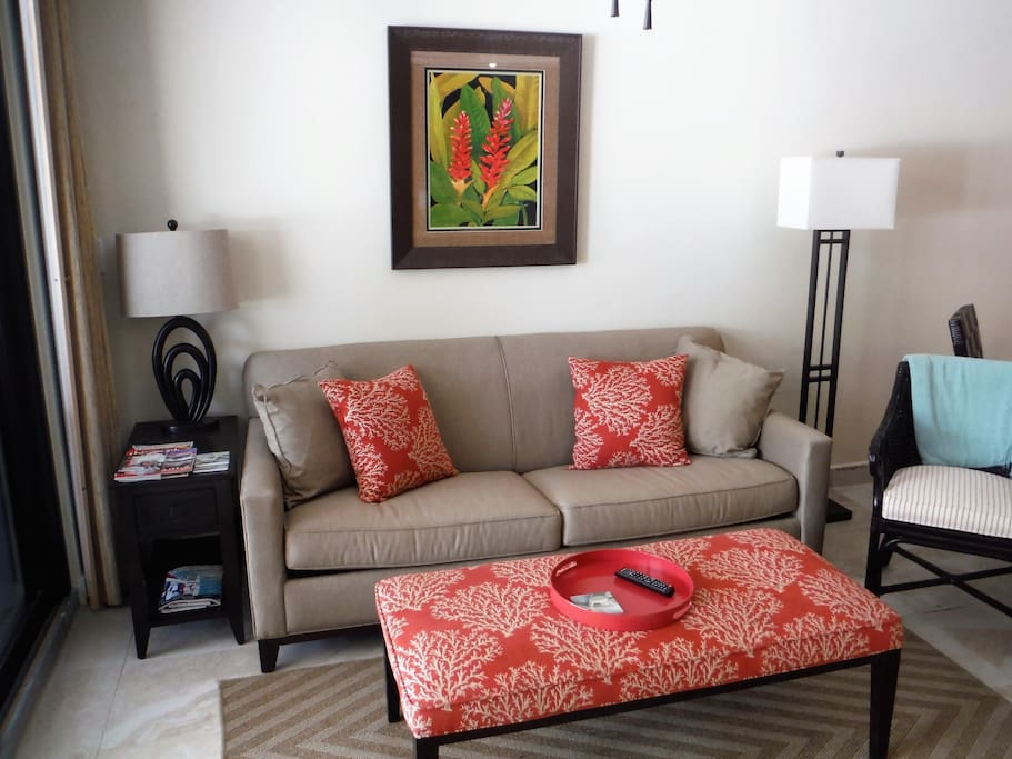 Pullout queen sized sofa bed in living room area with very comfortable memory foam mattress.