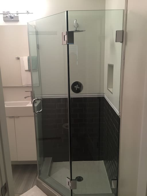 Private rain fall shower in full bathroom.