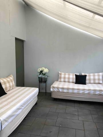 Overflow bedroom off lounge/ This is an indoor / outdoor room which is screened and weather proof but not glassed  in
