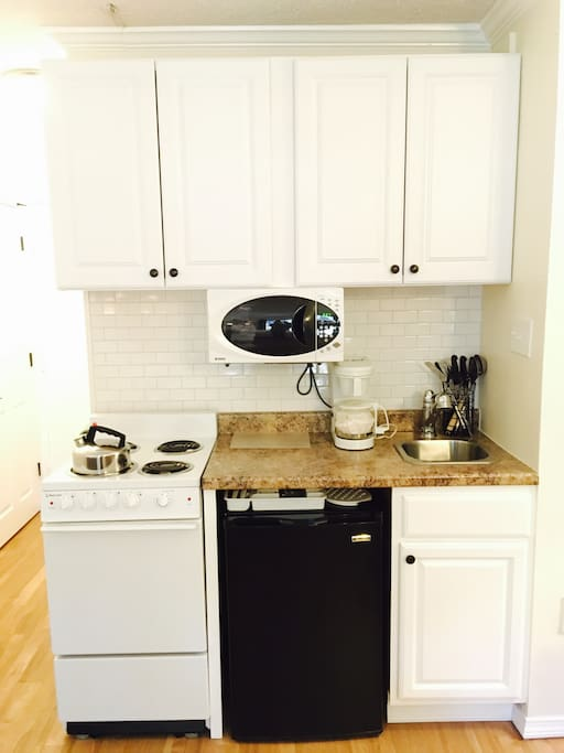 Kitchenette-sink, oven, stove, under-counter fridge, microwave, coffee maker, toaster