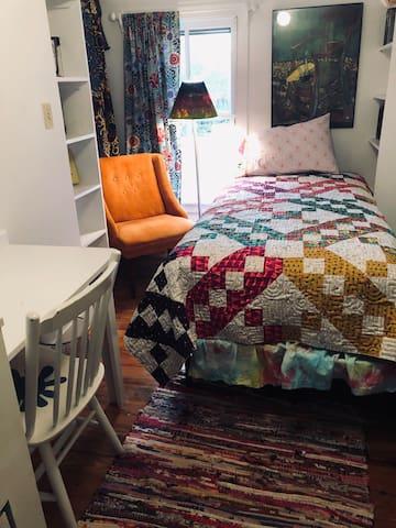 This quilt from Sewlovelee features designer Alison Glass' Road Trip fabric line.