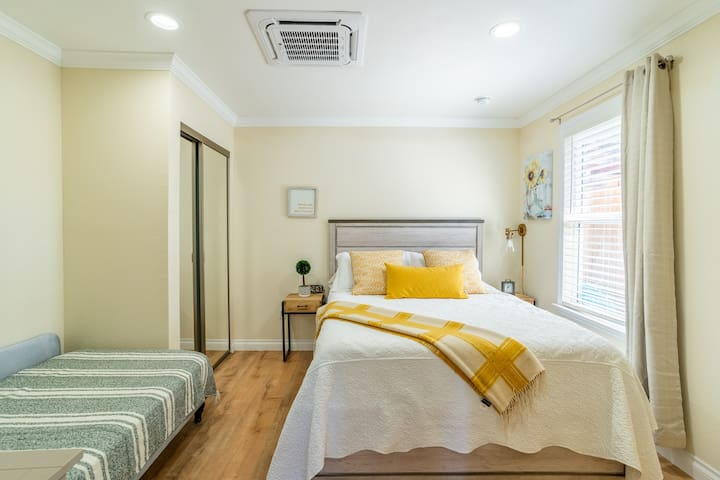 Bedroom with queen size bed and a twin size day bed.
