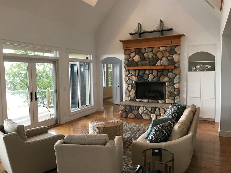 """Fireplace, 32"""" TV in the cabinet and great lake views - looking from the kitchen."""