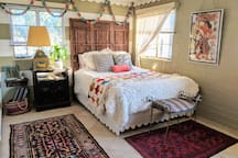 Queen Bed with view of back and side yard.