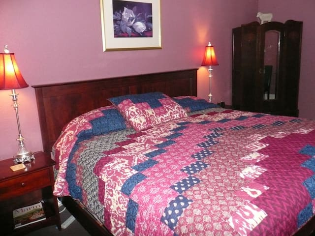 large room with king bed and private bathroom