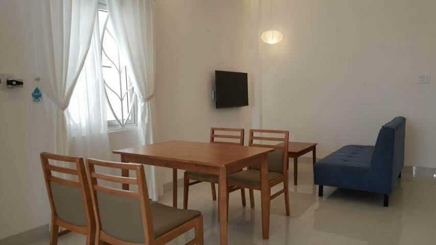 A set of table and 4 chairs, a tivi corner with sofa. A lot of windows for this bright apartment...