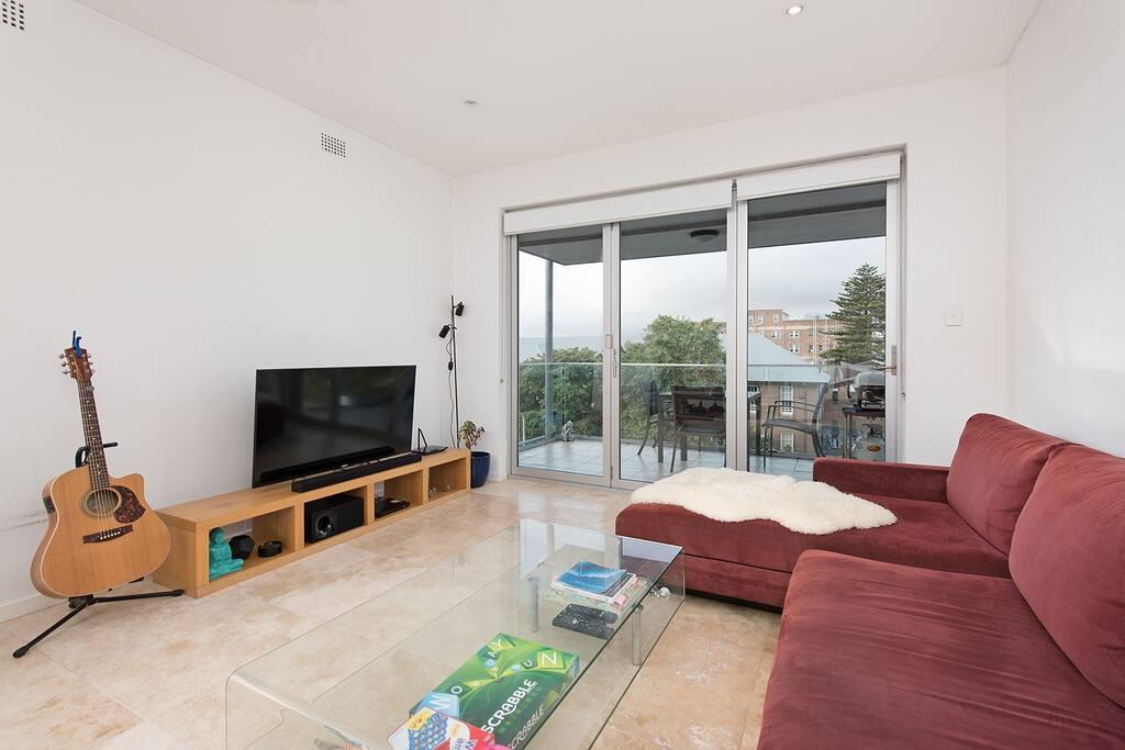 Open plan living area with balcony overlooking Bondi Beach