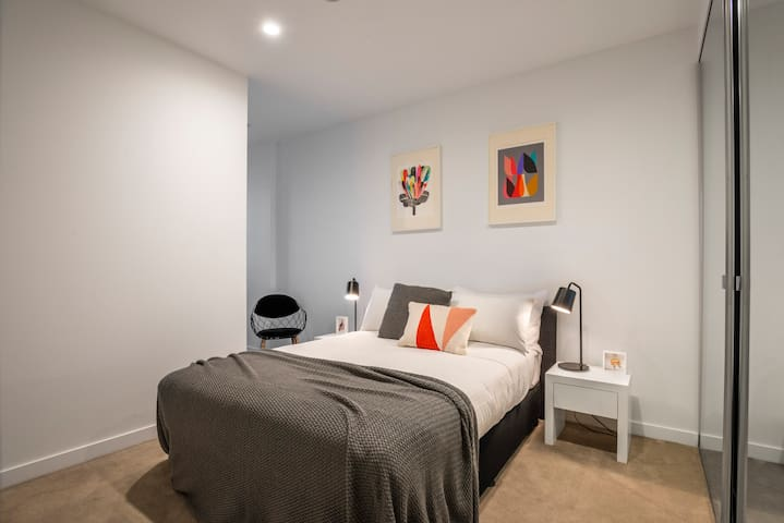 The master bedroom is complete with queen bed, large robe to store you luggage and belongings and study nook