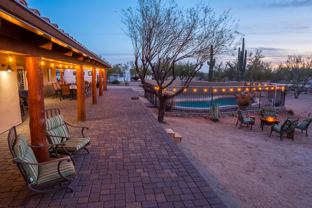The property sits on 1.2 acres of land and includes a large back porch, multiple seating areas, fire pit, pool and a palo verde forest.