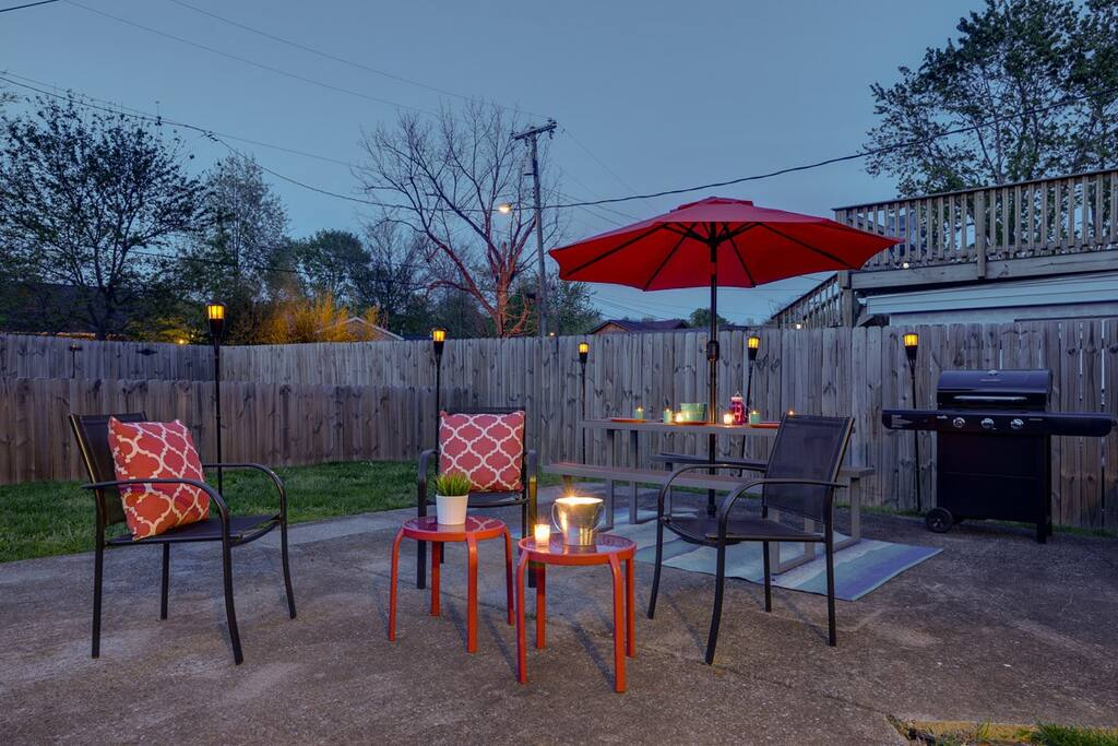 Relax on patio furniture while dinner sizzles on the grill