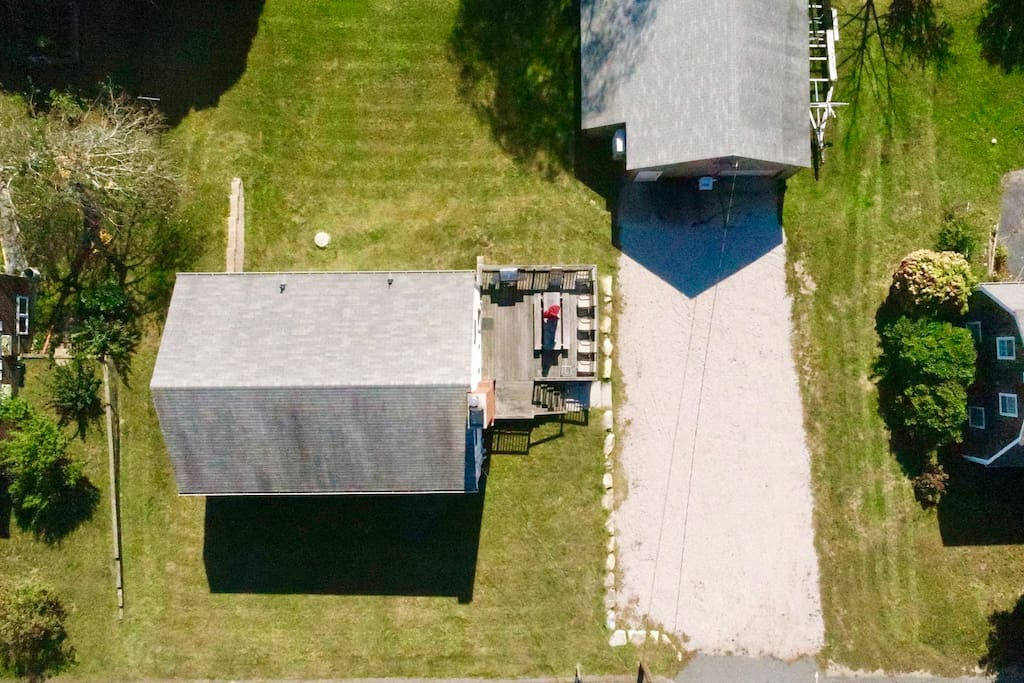 Ariel footage of property. Large driveway.