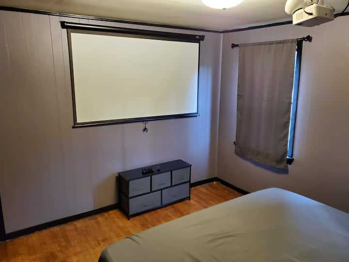 Private bedroom with king bed and projector