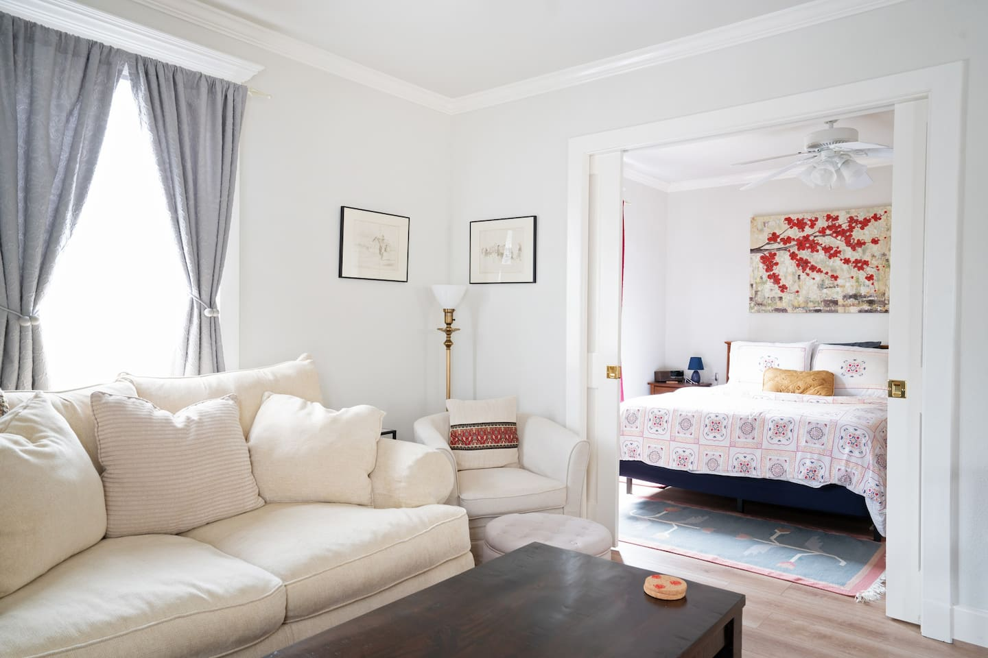A bright and cozy one bedroom apartment with the kitchen, dining and living areas in a large open concept space.