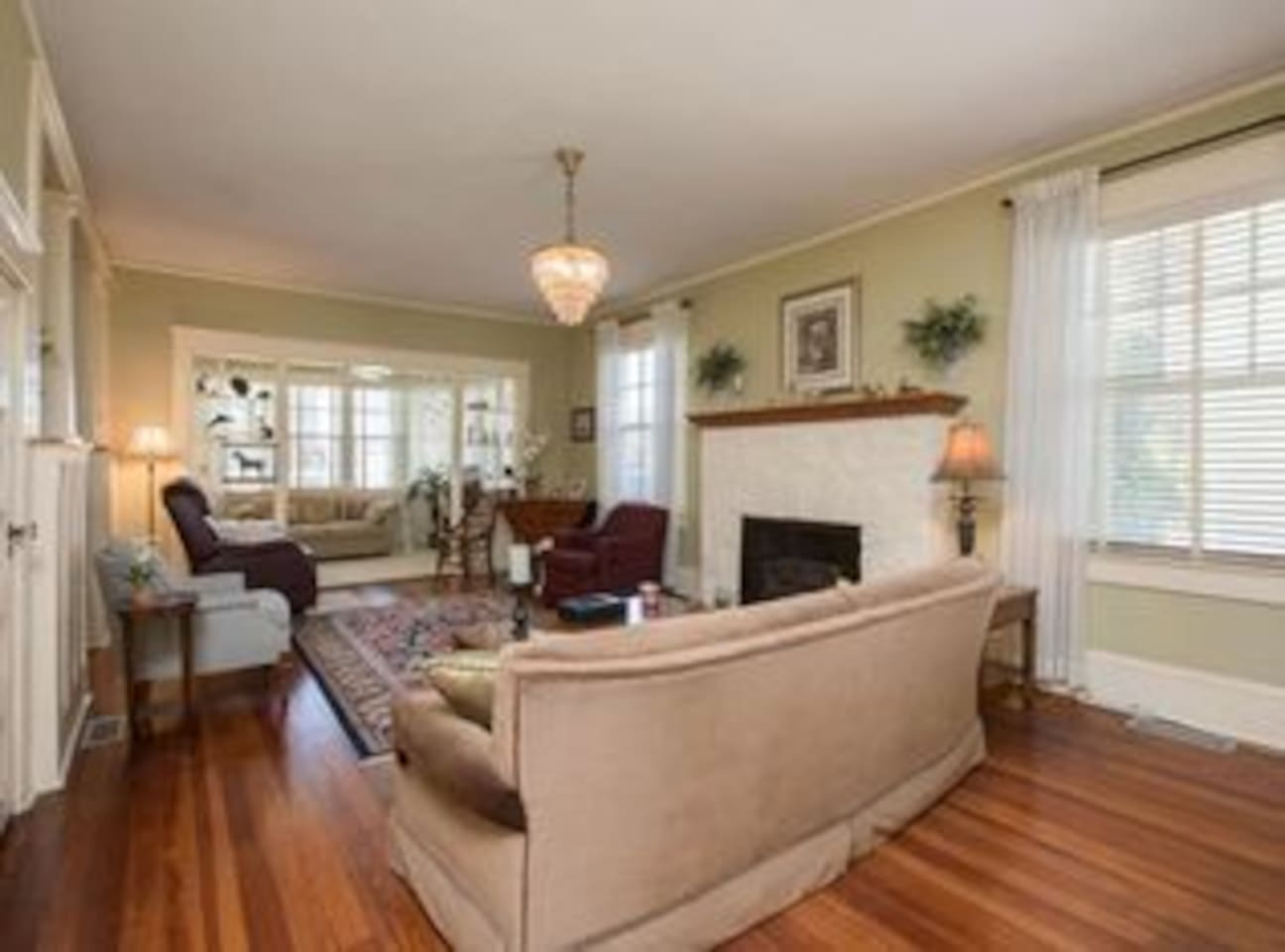 Spacious living area with cable television.