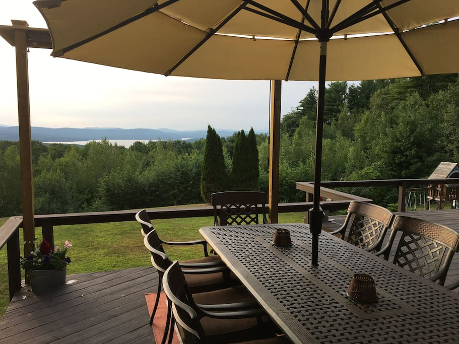 Enjoy gorgeous panoramic lake and mountain views from our shaded patio set for 8