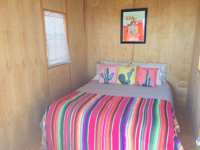 Full bed. This guesthouse is small and simple. Perfect for travelers who enjoy being 'out of the house' and exploring the Big Bend with a cozy place to sleep at night. Centrally located there are bars, restaurants, art galleries, a cafe and shops within walking distance.