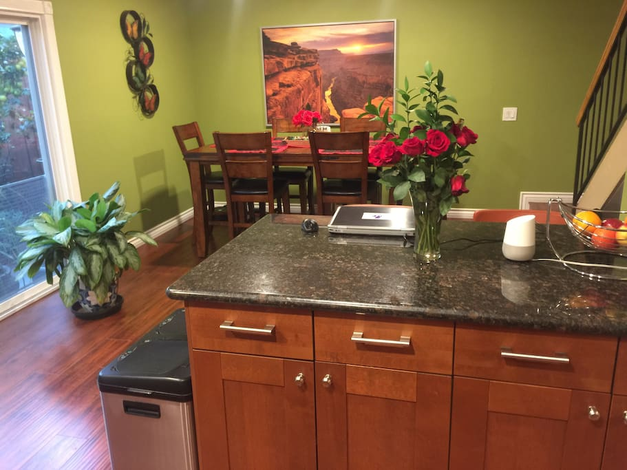 Kitchen area with dining table.