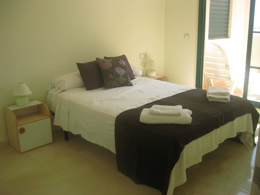 Double Bedroom with ensuite and access to patio.