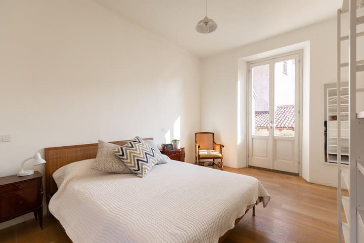 Bedroom with French doors  to balcony