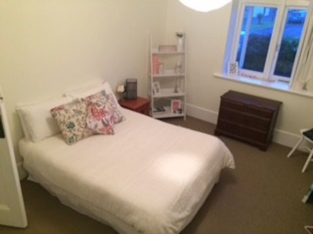 Bedroom 1 with drawers, wardrobe and study desk.
