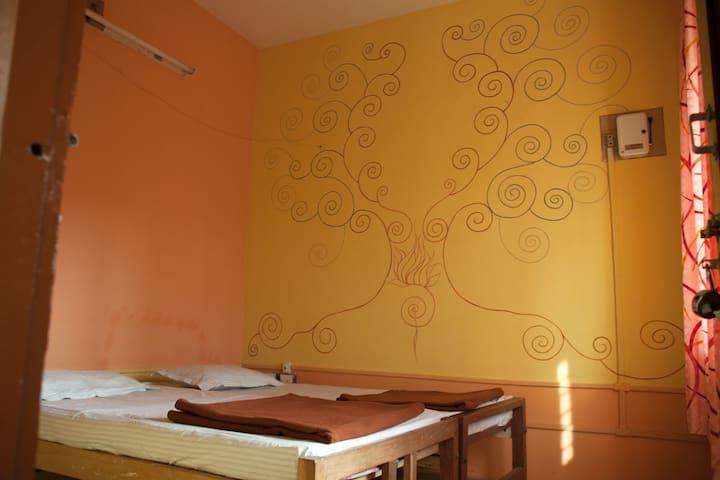 Sunny Orange Room in Rural Wayanad