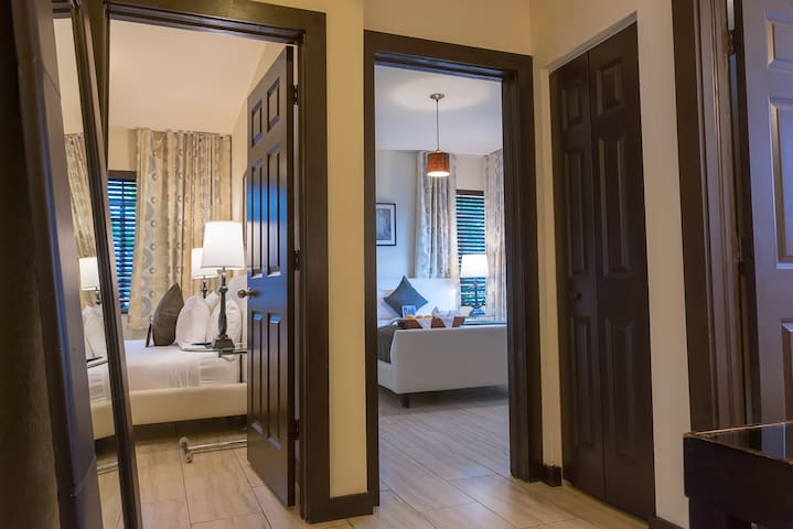 Large Two Bedroom Apartment Suite with Queen Bed in Each Room, Two Bathrooms, Full Kitchen, and Pool. Perfect for Families. Close to the Beach.