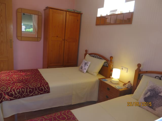 Twin bedroom which faces the pool and garden but still very private as not overlooked.