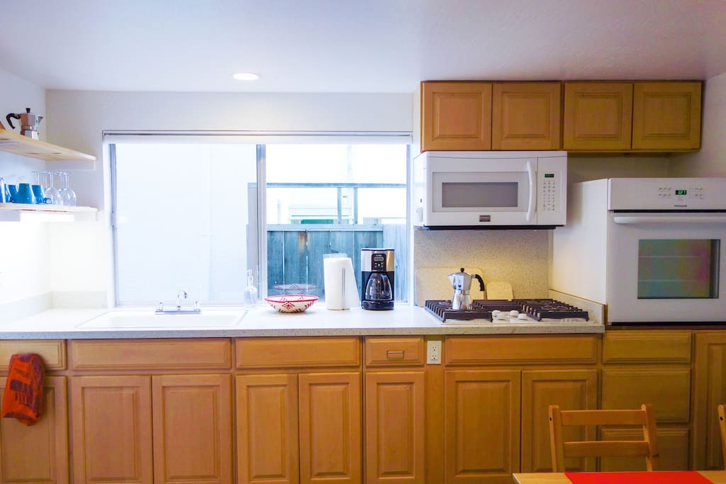Cook like you're at home. Fully equipped kitchen with gas stovetop, microwave, oven and fridge