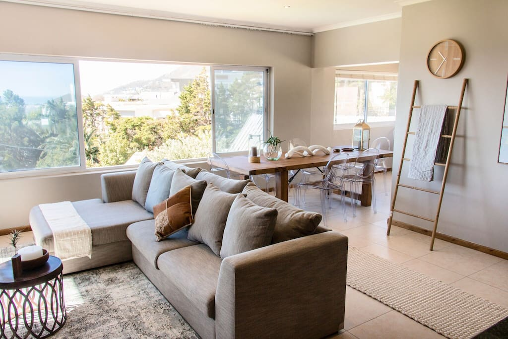 Open plan living area with sea views, Lion's head and Table mountain, DSTV, open to patio and large garden