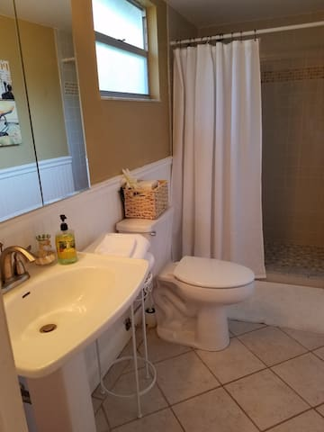 Private guest bathroom with shower off dinning room