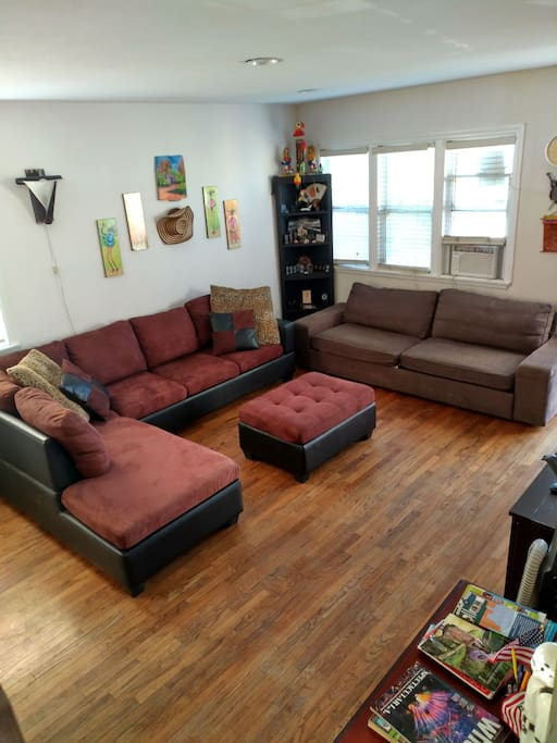 New sofa set with sofa bed near window