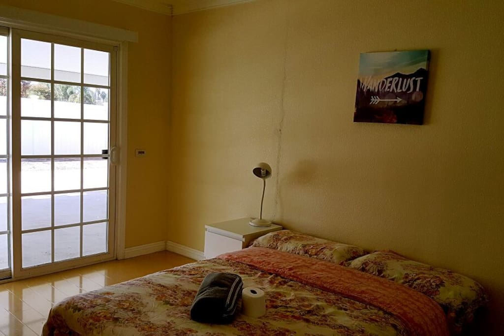 spacious room has a slide door goes to the yard